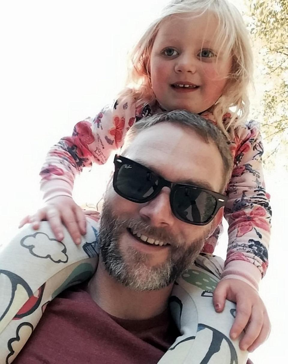 Mr Dawson with his young daughter (SWNS)
