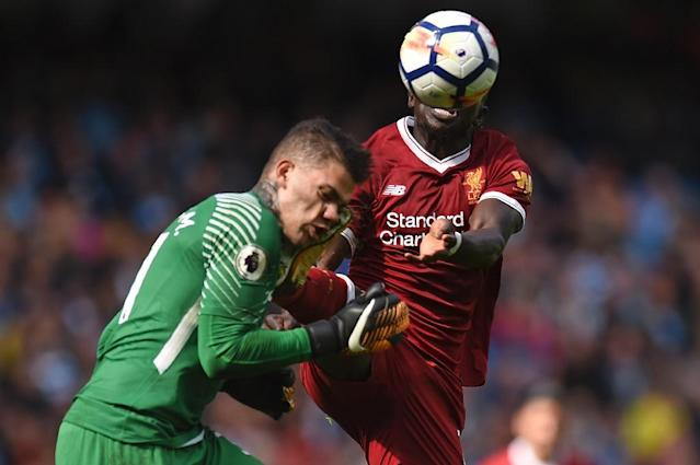 Fouls such as Sadio Mane's (R) challenge of Ederson (L) are not deliberate or malicious, said Pep Guardiola (AFP Photo/Oli SCARFF )