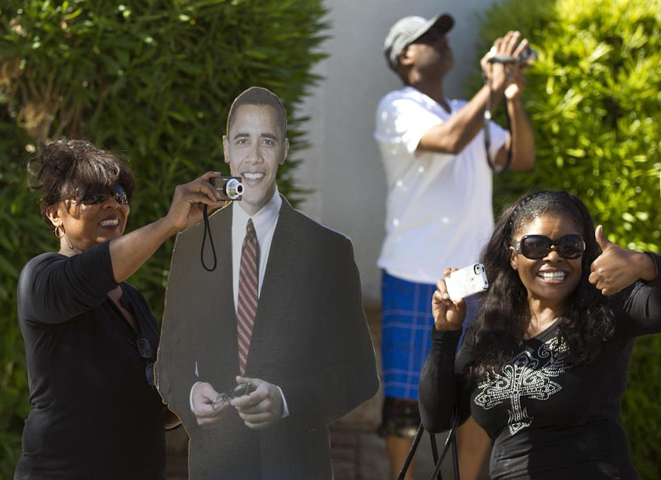 Supporters with a life sized cardboard cutout of President Barack Obama line the streets in View Park where he is participating in a fundraiser, Thursday, June 7, 2012, in Los Angeles. (AP Photo/Carolyn Kaster)