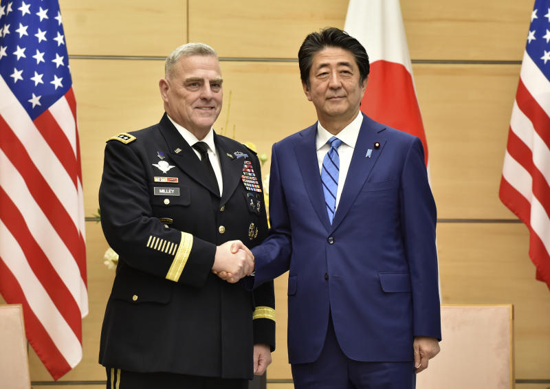 Japan's Prime Minister Shinzo Abe, right, shakes hands with U.S. Chairman of the Joint Chiefs of Staff Gen. Mark Milley, left, prior to their talks at the Abe's office in Tokyo Tuesday, Nov. 12, 2019. (Kazuhiro Nogi/Pool Photo via AP)