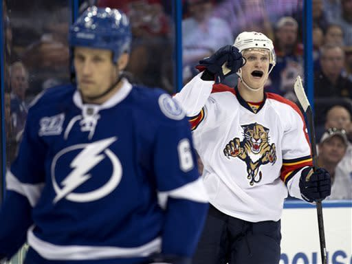 Florida Panthers center Nick Bjugstad, right, celebrates his goal against the Tampa Bay Lightning during the first period of an NHL hockey game Saturday, April 27, 2013, in Tampa, Fla. Skating away is Lightning's Sami Salo, of Finland. (AP Photo/Chris O'Meara)