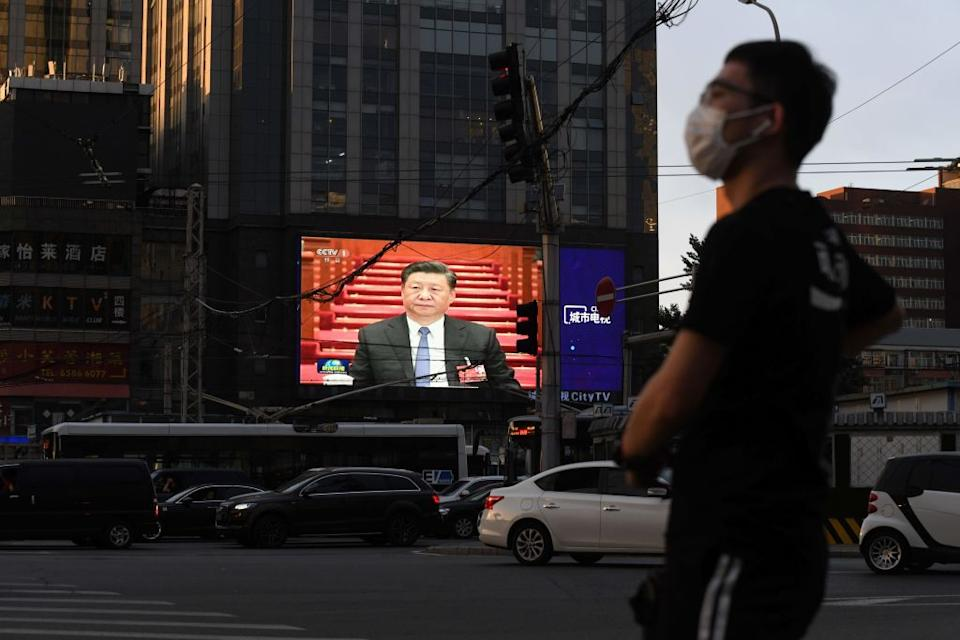 Chinese President Xi Jinping displayed at an intersection in Beijing in May. Source: Getty