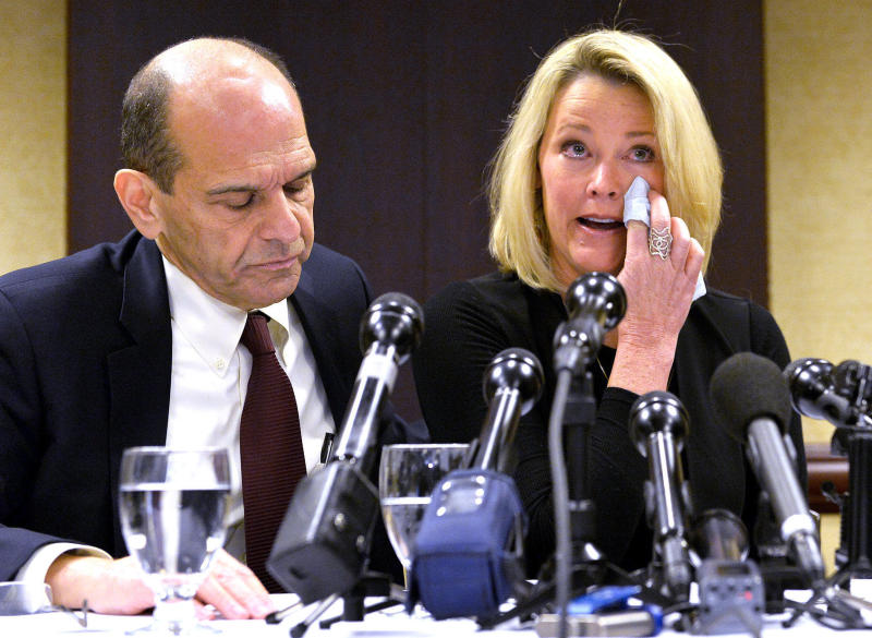 Former Boston news anchor Heather Unruh sits with her attorney Mitchell Garabedian at a press conference in Boston November 8, 2017.