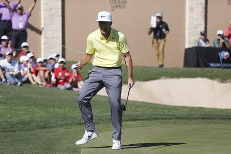 Apr 23, 2017; San Antonio, TX, USA; Kevin Chappell celebrates after sinking his last putt to win the Valero Texas Open at TPC San Antonio- AT&T Oaks Course. Mandatory Credit: Soobum Im-USA TODAY Sports