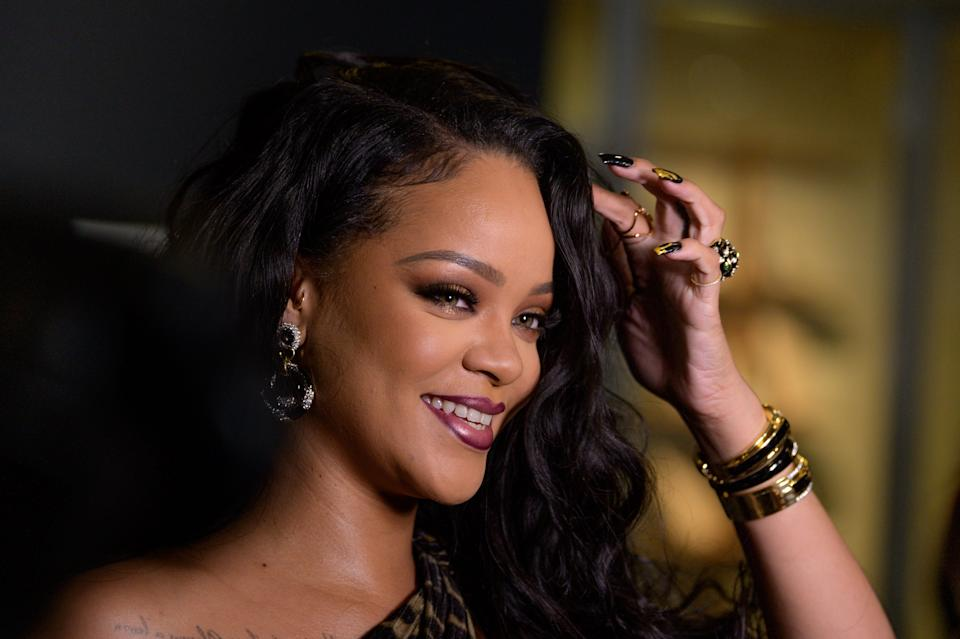 """Rihanna paired pink and plum lipstick at the launch of her first visual autobiography, """"Rihanna,"""" back in 2019."""