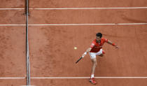 Serbia's Novak Djokovic plays a return to Lithuania's Ricardas Berankis during their third round match on day 7, of the French Open tennis tournament at Roland Garros in Paris, France, Saturday, June 5, 2021. (AP Photo/Thibault Camus)