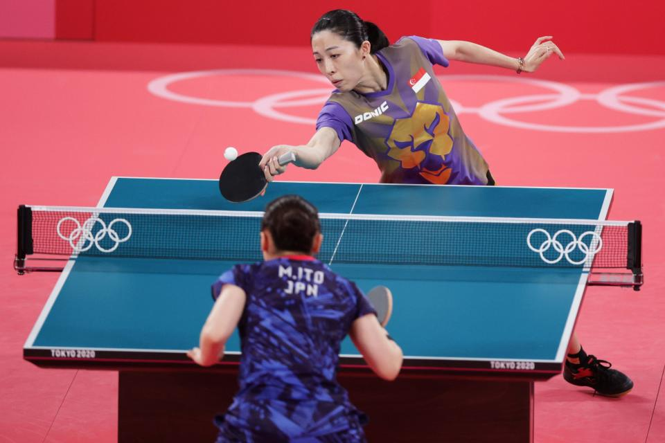 Singapore paddler Yu Mengyu returns a shot against Mima Ito of Japan in the women's singlers bronze-medal match at the 2020 Tokyo Olympics.