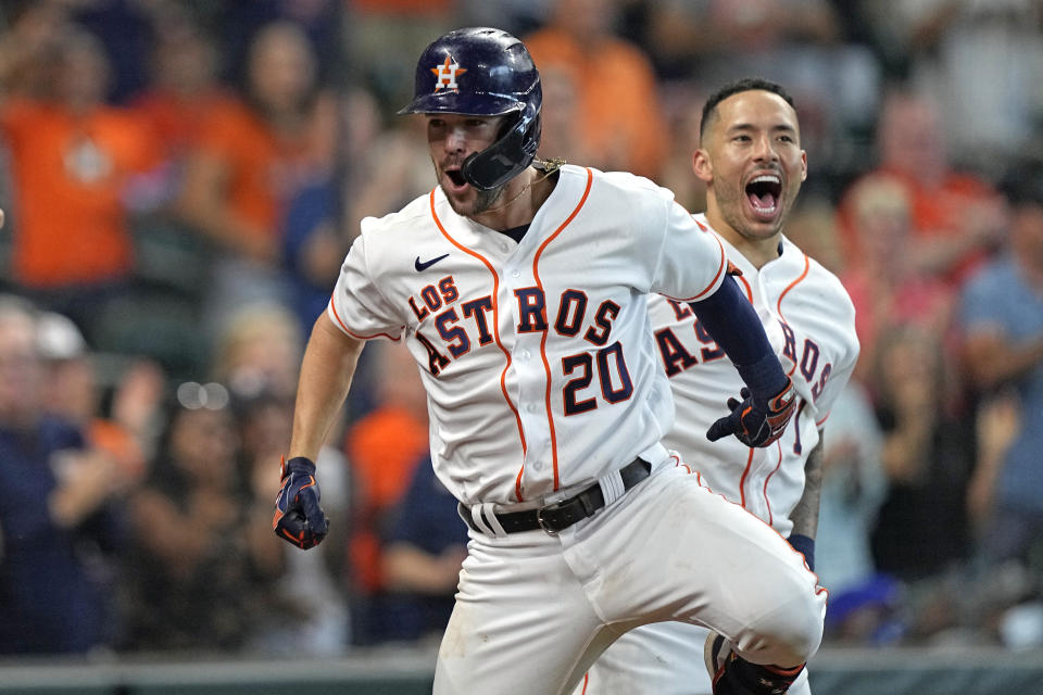 Houston Astros' Chas McCormick (20) celebrates with Carlos Correa (1) after hitting a home run against the Arizona Diamondbacks during the eighth inning of a baseball game Sunday, Sept. 19, 2021, in Houston. (AP Photo/David J. Phillip)