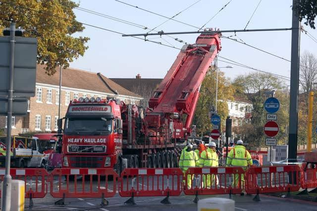A crane is raised into position at the scene near the tram crash in Croydon, Surrey, in 2016