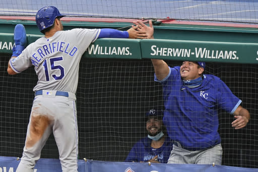 Kansas City Royals' Whit Merrifield (15) is congratulated by a teammate after scoring during the third inning of the team's baseball game against the Cleveland Indians, Thursday, Sept. 10, 2020, in Cleveland. (AP Photo/Tony Dejak)