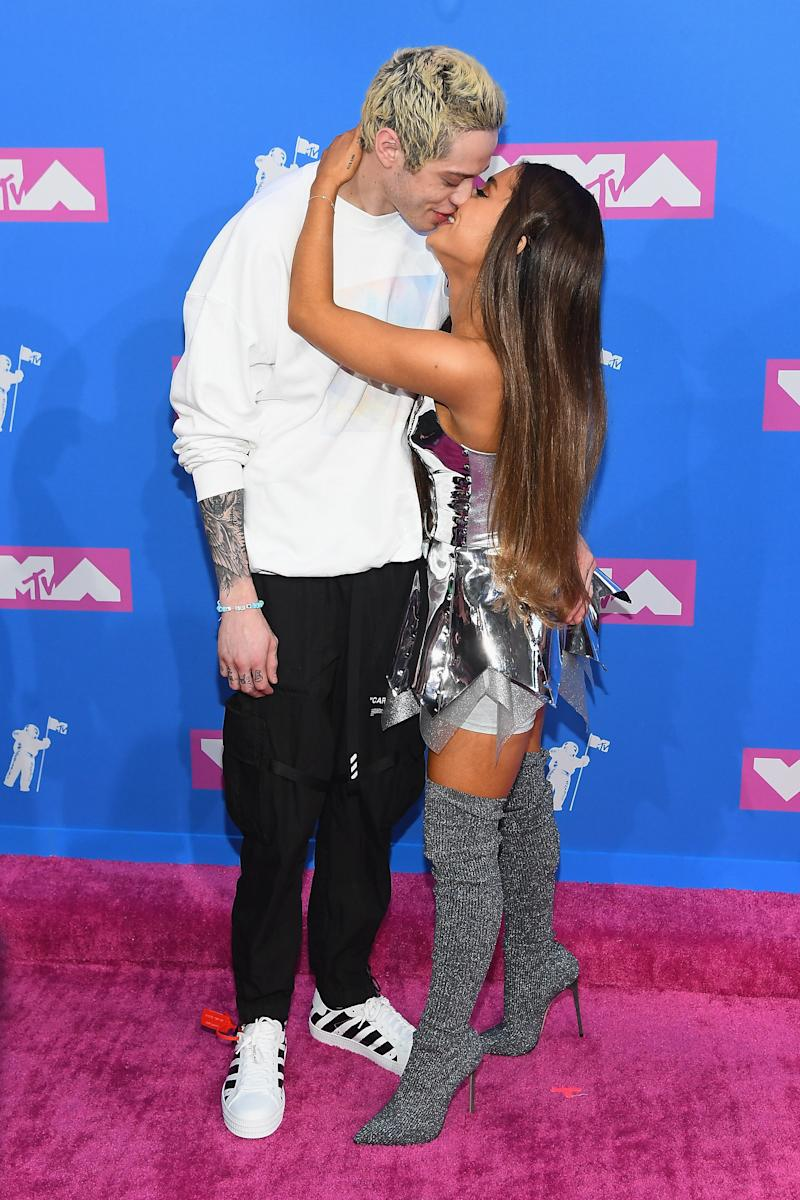 The two kiss on the red carpet. (Nicholas Hunt via Getty Images)