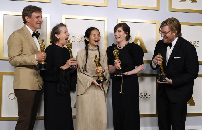 """Producers Peter Spears, from left, Frances McDormand, Chloe Zhao, Mollye Asher and Dan Janvey, winners of the award for best picture for """"Nomadland,"""" pose in the press room at the Oscars on Sunday, April 25, 2021, at Union Station in Los Angeles. (AP Photo/Chris Pizzello, Pool)"""