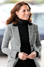 <p>Here's Kate donning a very similar blazer 35 years later, layered over a black turtleneck jumper at Basildon Sporting Village in October 2018.</p>