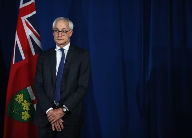 Ontario's chief coroner Dr. Dirk Huyer looks on during a daily COVID-19 press briefing at Queen's Park in Toronto on  June 23, 2020.  (Steve Russell/The Canadian Press - image credit)