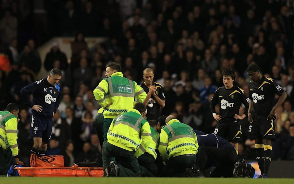 Fabrice Muamba is treated by pitch-side medics after collapsing at Tottenham's White Hart Lane in March 2012 - Richard Heathcote/Getty Images Sport