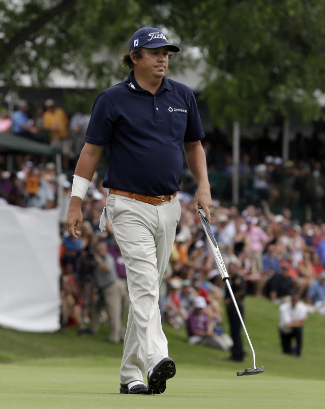 Jason Dufner reacts after missing a putt on the third playoff on the 18th hole during the final round of the PGA Colonial golf tournament in Fort Worth, Texas, Sunday, May 25, 2014. Adam Scott went on to win. (AP Photo/LM Otero)