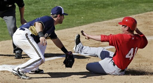Milwaukee Brewers' Taylor Green tags out Los Angeles Angels' Matt Young at third during the sixth inning of a spring training baseball game Saturday, March 2, 2013, in Phoenix. Young tried to get to third from first on a single by Hank Conger. (AP Photo/Morry Gash)