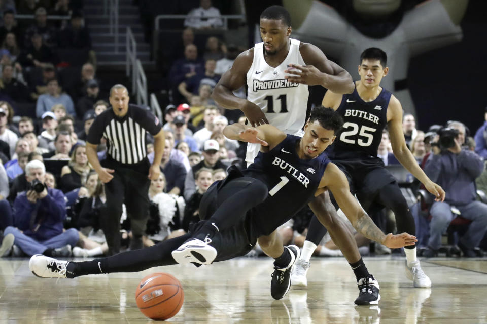 Butler forward Jordan Tucker (1) loses control of the ball in front of Providence guard Alpha Diallo (11) as Butler forward Christian David (25) watches during the first half of an NCAA college basketball game Friday, Jan. 10, 2020, in Providence, R.I. (AP Photo/Elise Amendola)