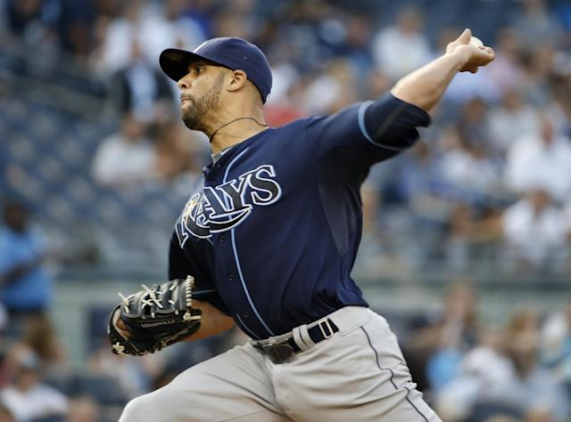 Tampa Bay Rays starting pitcher David Price delivers in the first inning of a baseball game against the New York Yankees at Yankee Stadium in New York, Tuesday, July 1, 2014. (AP Photo/Kathy Willens)