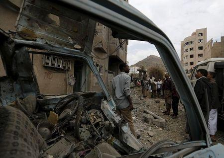 People gather at the site of a Saudi-led air strike in Yemen's capital Sanaa August 30, 2015.REUTERS/Khaled Abdullah