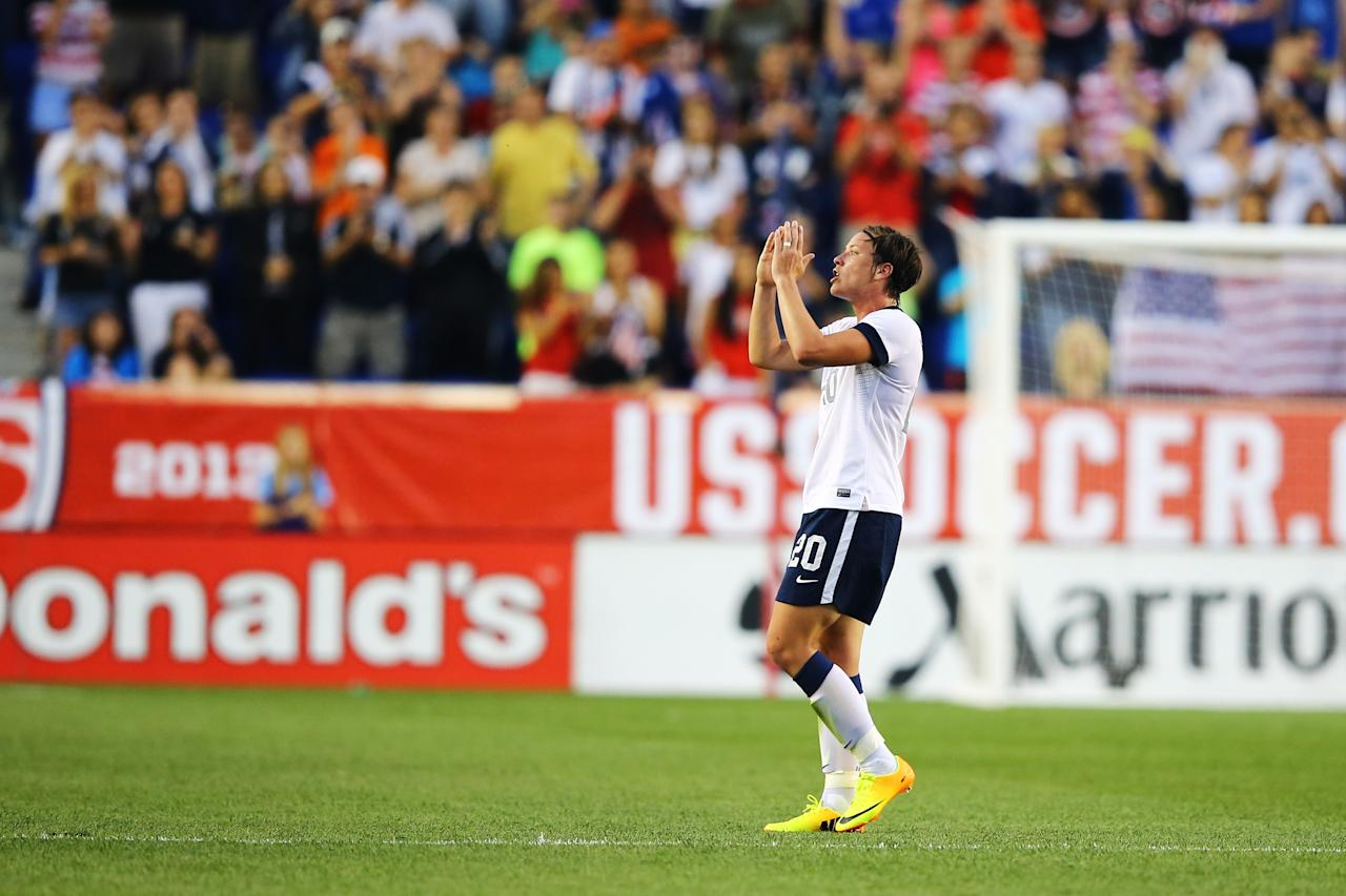 HARRISON, NJ - JUNE 20: Abby Wambach #20 of the USA reacts after passing Mia Hamm in alltime International total goals scored with her159th International goal against Korea Republic during the first half of their game at Red Bull Arena on June 20, 2013 in Harrison, New Jersey. (Photo by Al Bello/Getty Images)