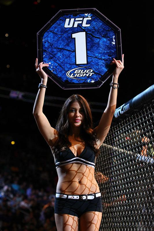 UFC Octagon Girl Arianny Celeste walks around the cage as Mark Bocek fights John Alessio during their lightweight bout for UFC 145 at Philips Arena on April 21, 2012 in Atlanta, Georgia.