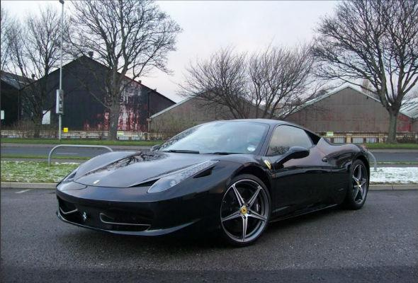 A one-of-a-kind Ferrari worth around £230,000 has been stolen in a daring robbery from a Surrey Dealership