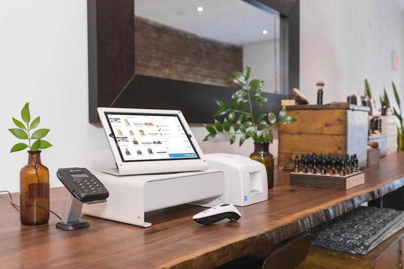 The Shopify point-of-sale system on the counter of a small boutique store.