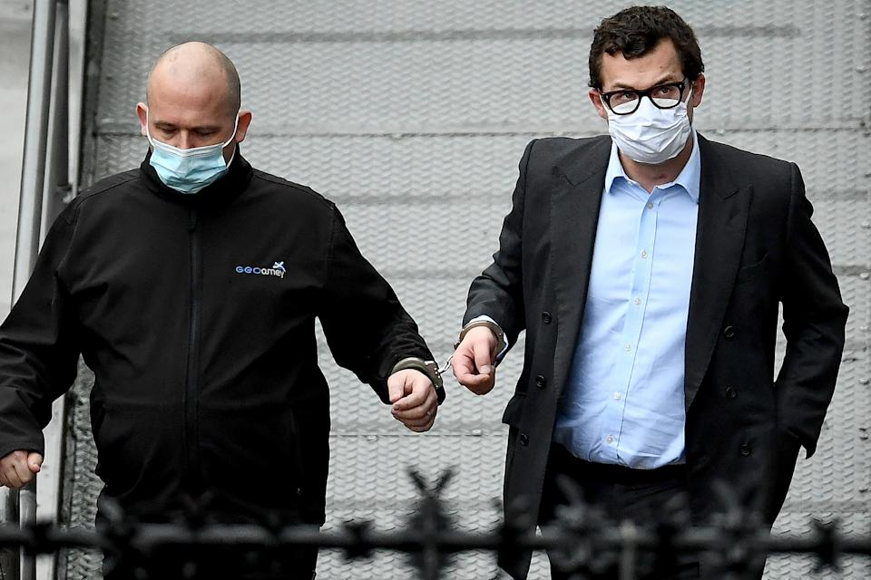 DUNDEE, SCOTLAND - FEBRUARY 23: Simon Bowes-Lyon, the the Earl of Strathmore, (R) leaves Dundee Sheriff Court in handcuffs after being sentenced to jail for 10 months for sexually assaulting a woman on February 23, 2021 in Dundee, Scotland. Bowes-Lyon, a distant cousin of Queen Elizabeth, pleaded guilty to forcing his way into the room of a guest at Glamis Castle, where he was hosting a function, and assaulting her. (Photo by Jeff J Mitchell/Getty Images)