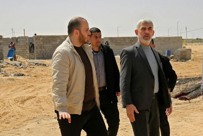 Palestinian Islamist movement Hamas leader in the Gaza Strip Yahya Sinwar (R) visits the construction site of a field hospital to house coronavirus patients in the southern Gaza Strip on March 23 (AFP Photo/SAID KHATIB)