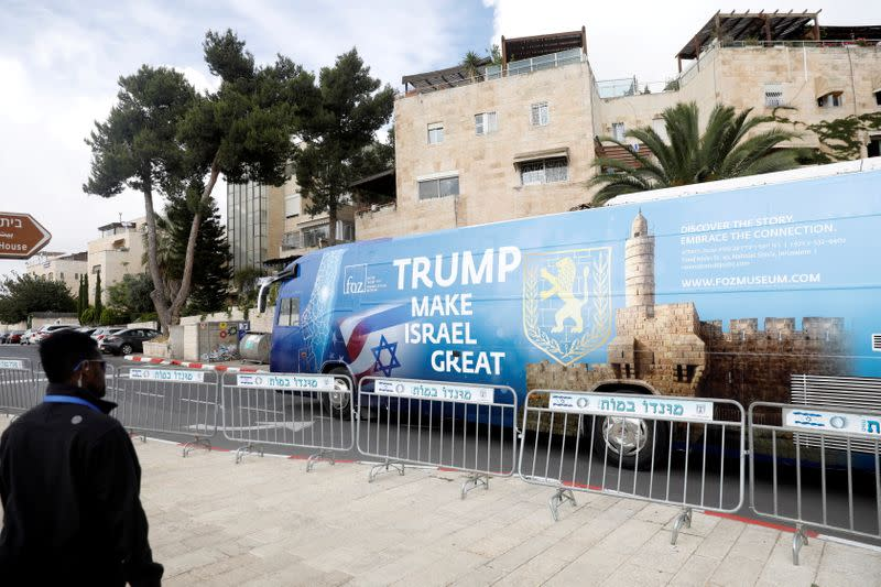 FILE PHOTO: A bus decorated with Israeli and U.S. flags and a message welcoming the move of the U.S. embassy to Jerusalem is seen near the location of the new U.S. embassy in Jerusalem