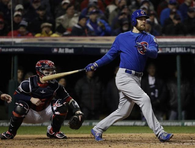 Ben Zobrist follows through on his RBI triple during the fifth inning of World Series Game 2. (AP)