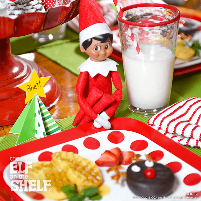"""<p>Pretzels make up the pointy antlers of this chocolate-covered doughnut """"reindeer,"""" while red candy-coated chocolates stand in for the nose (but of course!). There's no more delicious entrance out there!</p><p><strong>Get the tutorial at <a href=""""https://elfontheshelf.com/elf-ideas/welcome-back-breakfast/"""" rel=""""nofollow noopener"""" target=""""_blank"""" data-ylk=""""slk:Elf on the Shelf"""" class=""""link rapid-noclick-resp"""">Elf on the Shelf</a>.</strong></p>"""