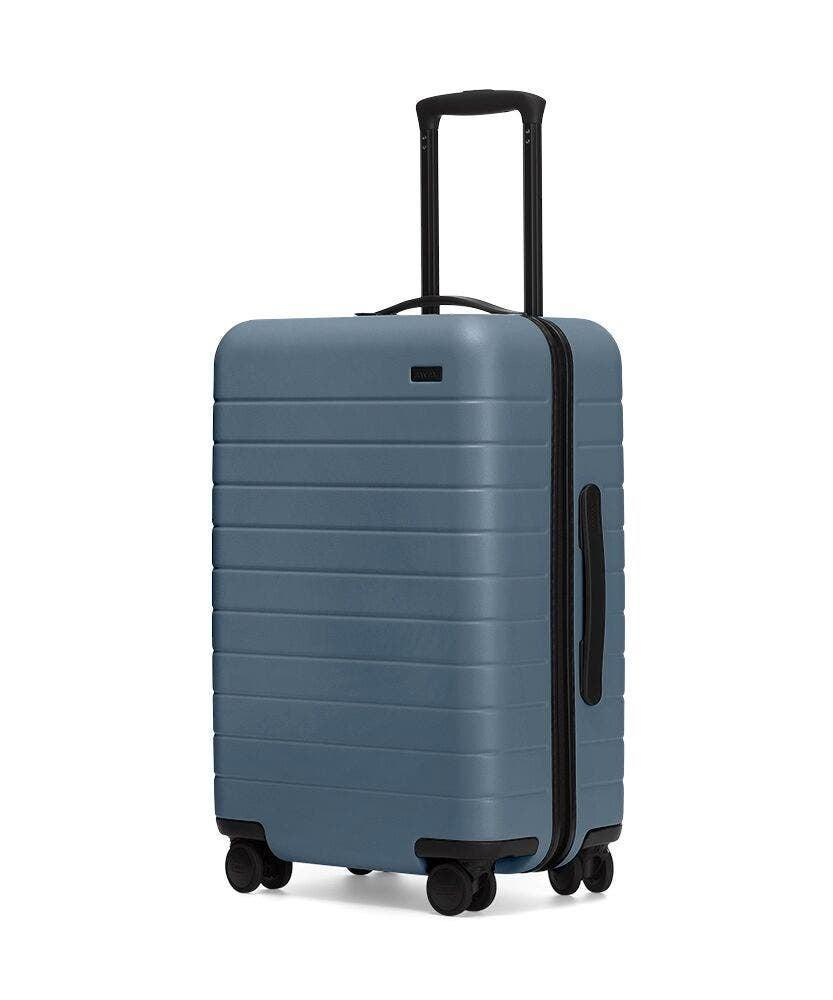 """<h2>Away The Bigger Carry-On</h2><br><strong>The Type: </strong>Large carry-on roller bag<br><br><strong>The Hype:</strong> 4.9 out of 5 stars and 2,956 reviews on Away<br><br><strong>What Travelers Say: </strong>""""I have used my bigger carry-on and everywhere bag twice. I always have my hairdryer, two large makeup, and accessory bags at least three pairs of shoes. I put all of this on the zipper side. I put gym clothes and 5-6 outfits on the other side. This is my first split hard side and this design keeps everything more organized."""" – <em>Jolene M., Away Reviewer</em><br><br><em>Shop</em> <strong><em><a href=""""http://awaytravel.com"""" rel=""""nofollow noopener"""" target=""""_blank"""" data-ylk=""""slk:Away"""" class=""""link rapid-noclick-resp"""">Away</a></em></strong><br><br><br><br><strong>Away</strong> The Bigger Carry-On, $, available at <a href=""""https://go.skimresources.com/?id=30283X879131&url=https%3A%2F%2Fwww.awaytravel.com%2Fsuitcases%2Fbigger-carry-on%2Fblack"""" rel=""""nofollow noopener"""" target=""""_blank"""" data-ylk=""""slk:Away"""" class=""""link rapid-noclick-resp"""">Away</a>"""