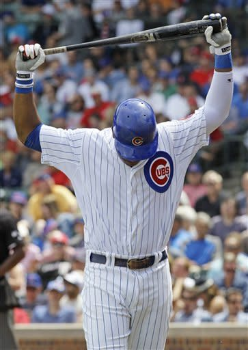 Chicago Cubs' Starlin Castro reacts after being called out on strikes during the first inning of a baseball game against the Cincinnati Reds in Chicago, Friday, Aug. 10, 2012. (AP Photo/Nam Y. Huh)