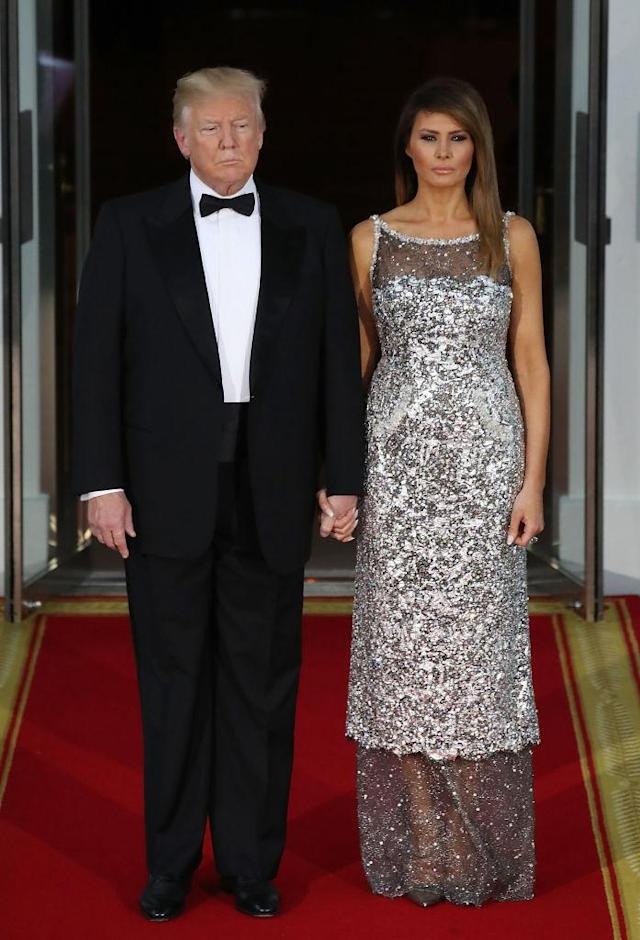 Standing alongside her husband, Melania wore a custom Chanel gown for the state dinner. (Photo: Getty Images)
