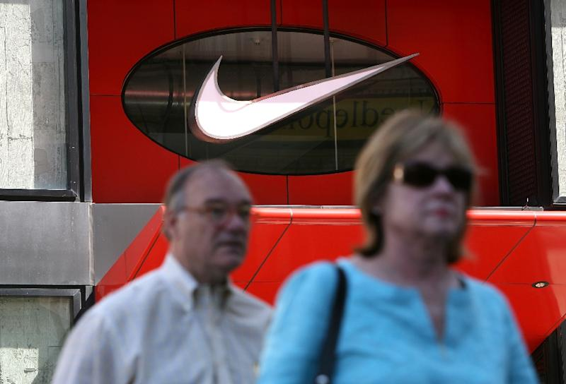 Dow member Nike surged 8.9 percent afterearnings for the quarter ending August 31 jumped 22.6 percent to $1.2 billion (AFP Photo/Justin Sullivan)