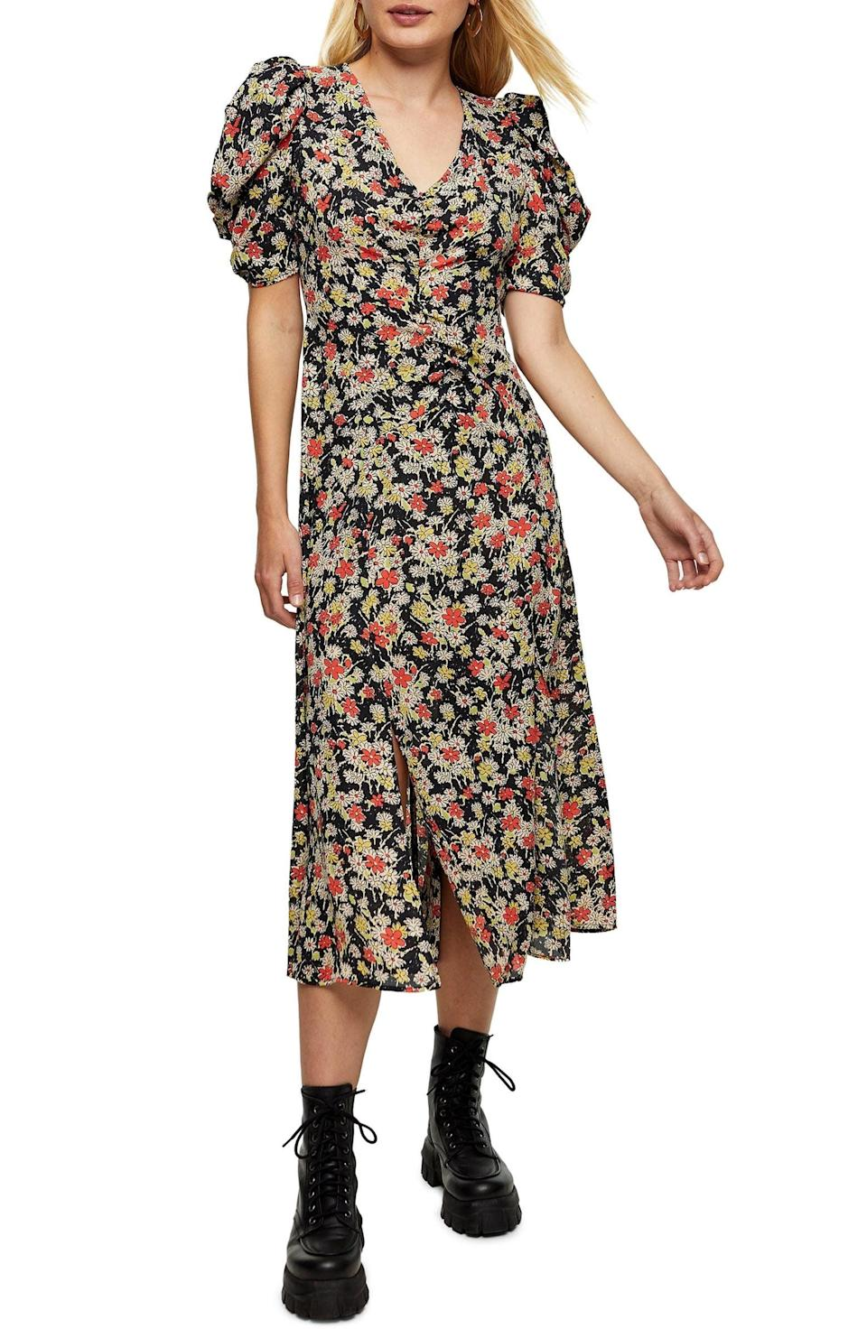 <p>You'll look effortlessly cool in this <span>Topshop Grunge Floral Print Midi A-Line Dress</span> ($90).</p>