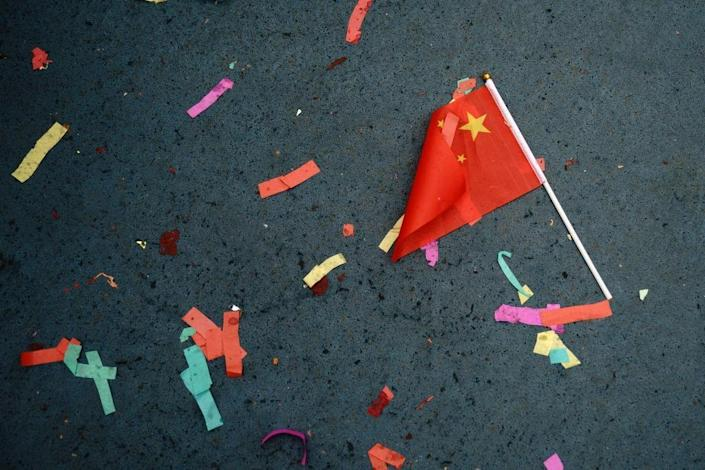 A Chinese flag lays on the ground in New York, 16 February 16, 2018: Getty Images