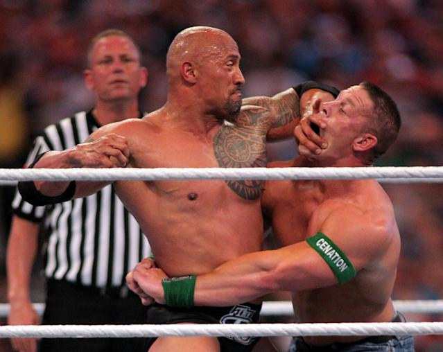 Dwyane 'The Rock' Johnson (L) competes against John Cena at WrestleMania XXVIII in Sun Life Stadium on April 1, 2012 in Miami, Florida. (Marc Serota/AP Images)