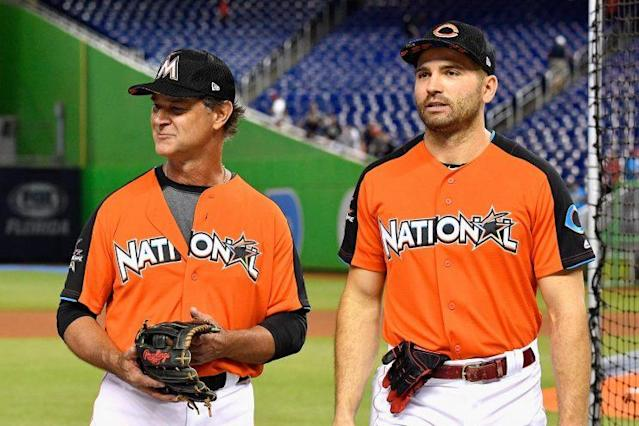 """<a class=""""link rapid-noclick-resp"""" href=""""/mlb/players/7946/"""" data-ylk=""""slk:Joey Votto"""">Joey Votto</a> (right) made sure <a class=""""link rapid-noclick-resp"""" href=""""/mlb/players/8628/"""" data-ylk=""""slk:Zack Cozart"""">Zack Cozart</a> got the ball from his first All-Star hit. (Getty Images)"""