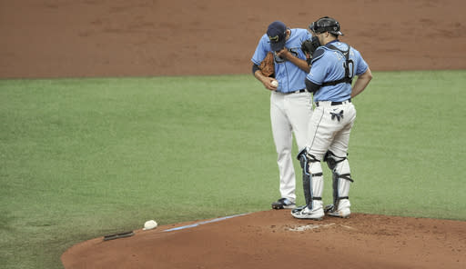 Tampa Bay Rays starter Charlie Morton, left, talks with catcher Mike Zunino, right, on the mound during the first inning of a baseball game against the New York Yankees, Sunday, Aug. 9, 2020, in St. Petersburg, Fla. (AP Photo/Steve Nesius)