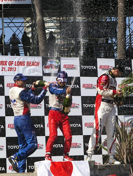 From left, Justin Wilson, of England, Takuma Sato, of Japan, and Graham Rahal celebrate on the podium after the IndyCar Series Grand Prix of Long Beach auto race, Sunday, April 21, 2013, in Long Beach, Calif. Sato took first, Rahal second and Wilson third. (AP Photo/Ringo H.W. Chiu)