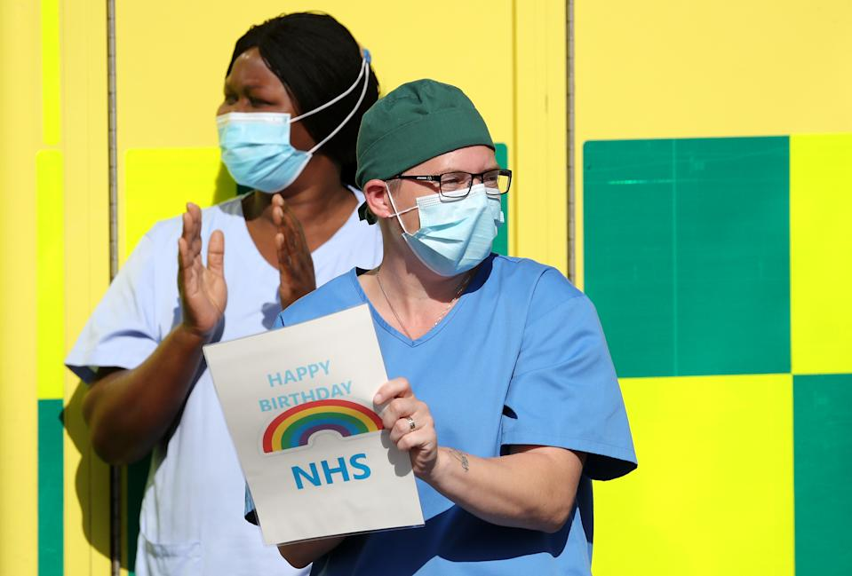 NHS staff outside the William Harvey Hospital in Ashford, Kent, join in the pause for applause to salute the NHS 72nd birthday. (Photo by Gareth Fuller/PA Images via Getty Images)