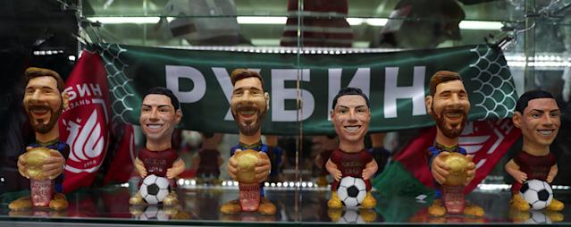 Figures depicting Argentina's star Lionel Messi and Portugal's star Cristiano Ronaldo are displayed for sale inside a souvenirs shop in Kazan, Russia, June 20, 2018. As well as shooting all the matches, Reuters photographers are producing pictures showing their own quirky view from the sidelines of the World Cup. REUTERS/Sergio Perez