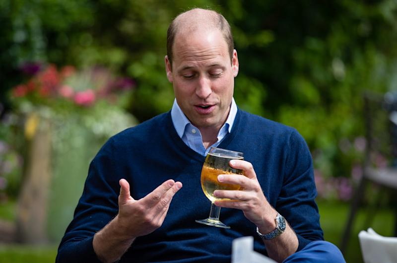 Prince William, Duke of Cambridge takes a sip of an Aspalls cider at The Rose and Crown pub (Getty Images)
