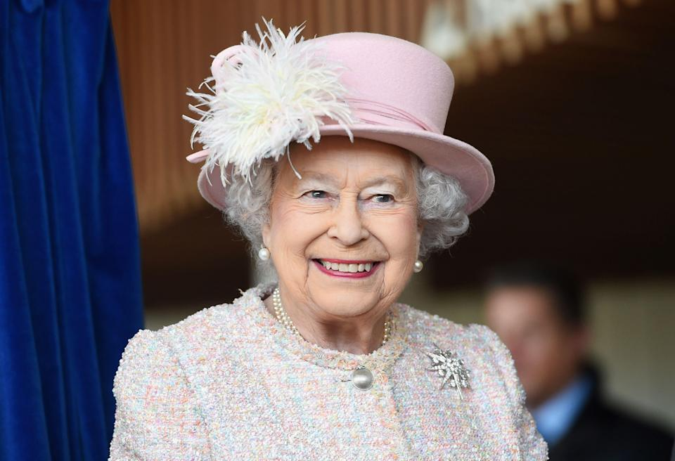 Queen Elizabeth II looks breath-taking in her pink color co-operate dress with pink hat to match