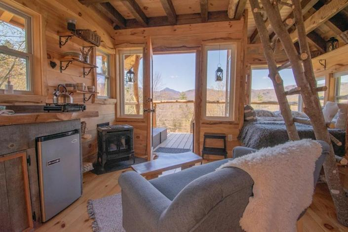 """<p><strong>Moretown, Vermont</strong></p> <p>The epitome of cozy feels, Lilla Rustica was built by the Tree House Guys, a local Vermont company. The hideaway is decked out with two queen-size beds in the loft and main living space, as well as an outhouse and a swimming hole for a rustic glamping experience. Take in views of Camel's Hump State Park from the intimate porch or head out on the nearby hiking trails.</p> $272, Airbnb. <a href=""""https://www.airbnb.com/rooms/43012788"""" rel=""""nofollow noopener"""" target=""""_blank"""" data-ylk=""""slk:Get it now!"""" class=""""link rapid-noclick-resp"""">Get it now!</a>"""