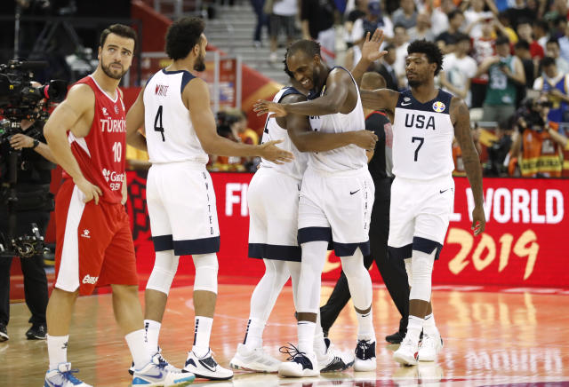 "<a class=""link rapid-noclick-resp"" href=""/nba/players/5073/"" data-ylk=""slk:Khris Middleton"">Khris Middleton</a> celebrates with Team USA after narrowly escaping with a victory. (Reuters)"