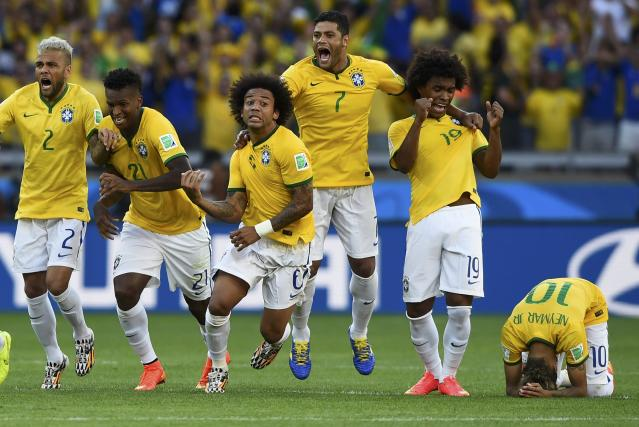 Brazil's national soccer players celebrate teammate Neymar's (R) decisive goal during a penalty shootout in their 2014 World Cup round of 16 game against Chile at the Mineirao stadium in Belo Horizonte June 28, 2014. Also pictured are (L-R) Brazil's Dani Alves, Jo,Marcelo, Hulk and Willian. REUTERS/Dylan Martinez (BRAZIL - Tags: SOCCER SPORT WORLD CUP TPX IMAGES OF THE DAY)